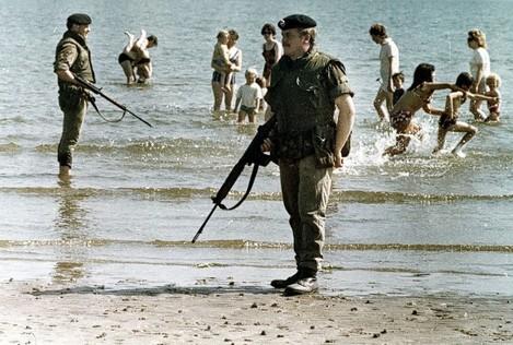 BRITISH TROOPS GUARD BEACH