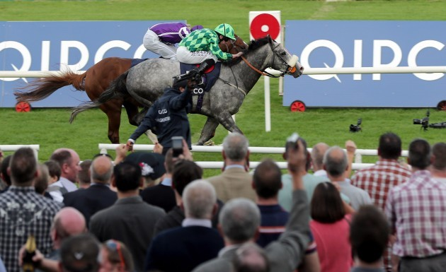 Ryan Moore onboard The Grey Gatsby comes home to win just ahead of Australia ridden by Joseph O'Brien