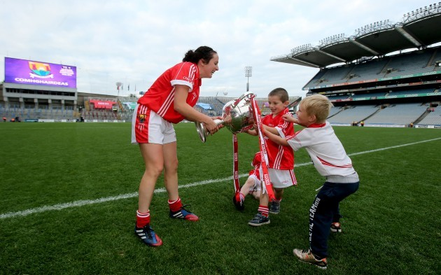 Geraldine OÕFlynn wrestles back The Brendan Martin Cup after two young fans ran off with it