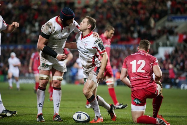 Darren Cave celebrates his try with Dan Tuohy