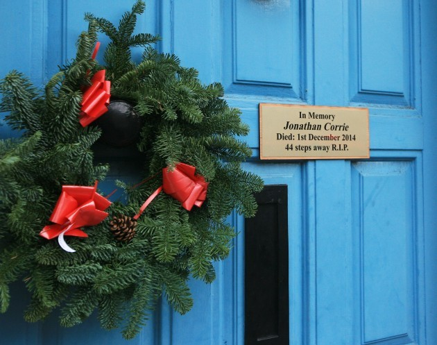 A plaque hangs on the door where homeless
