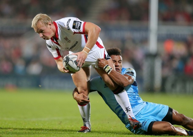 Luke Marshall is tackled by David Odiete