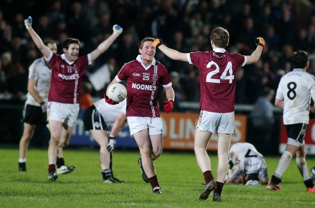 Slaughtneil players celebrate the final whistle