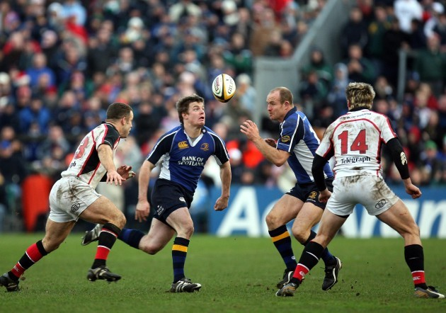 Brian O'Driscoll goes by Kevin Maggs and Tommy Bowe with Denis Hickie in close support