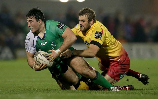 Denis Buckley tackled by Steven Shingler and Johan Snyman