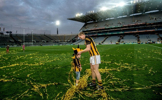 KilkennyÕs Henry Shefflin places a hat on his sons Henry's head after the game