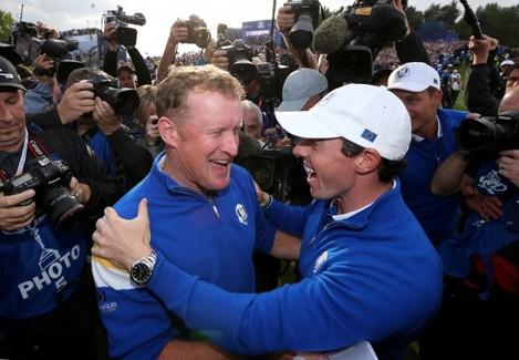Jamie Donaldson and Rory McIlroy celebrate