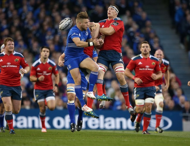Ian Madigan and Robin Copeland go for the ball