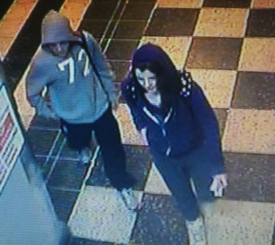 A CCTV image of the 2 young people