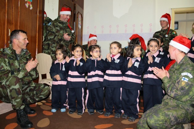 FINIRISHBATT troops visit a local orphanage in Tibnine as part of their Christmas celebrations.