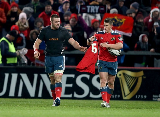 Ian Keatley returns the jersey to CJ Stander after scoring