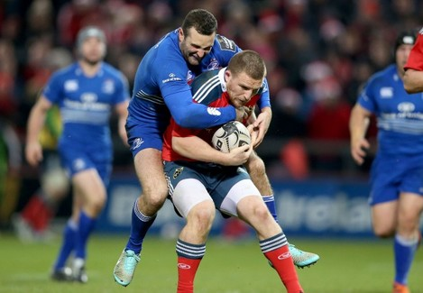 Andrew Conway tackled by Dave Kearney