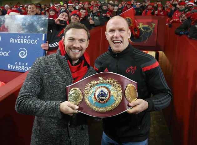 Andy Lee shows his belt off to the Munster fans at Halftime with Paul O'Connell