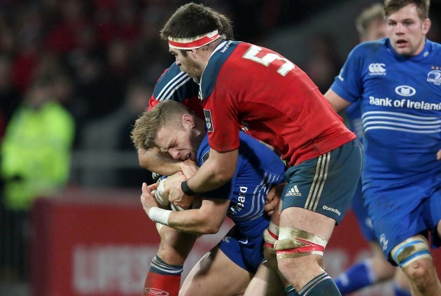 Ian Madigan is tackled by Billy Holland