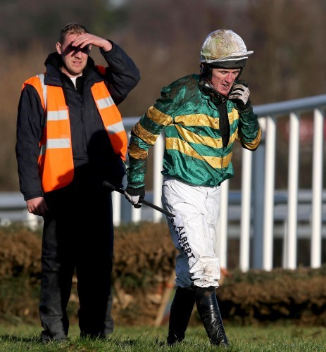 AP McCoy looks on after falling from Speckled Wood