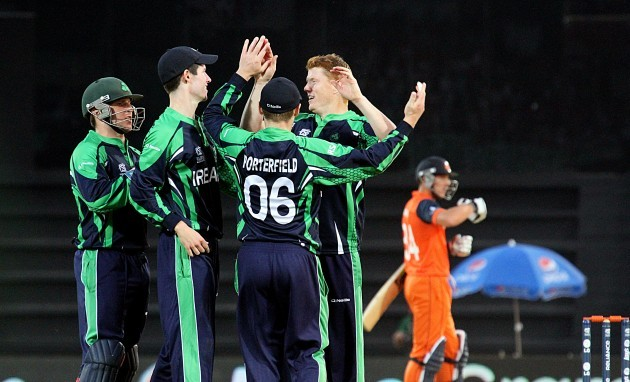 Kevin O'Brien is congratulated by teammates after taking a wicket
