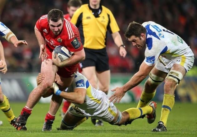 James Cronin is tackled by Damien Chouly and Jamie Cudmore