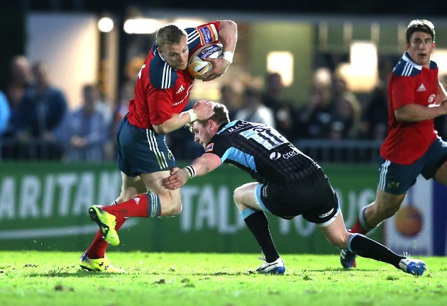 Keith Earls is tackled by Finn Russell
