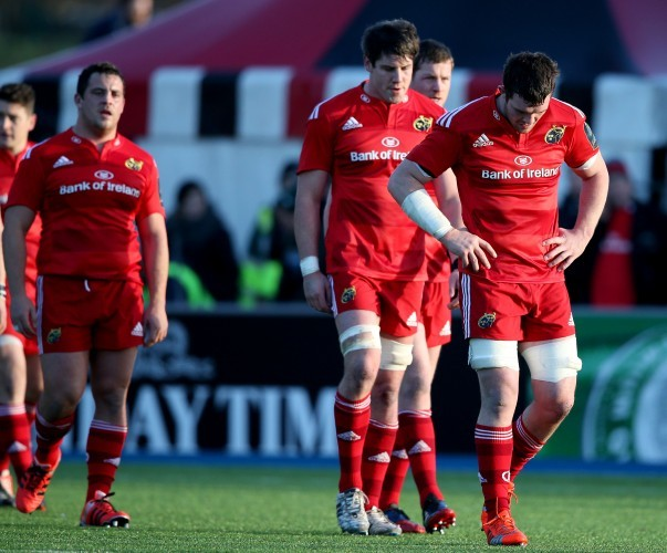 Peter O'Mahony leads his dejected players off the field