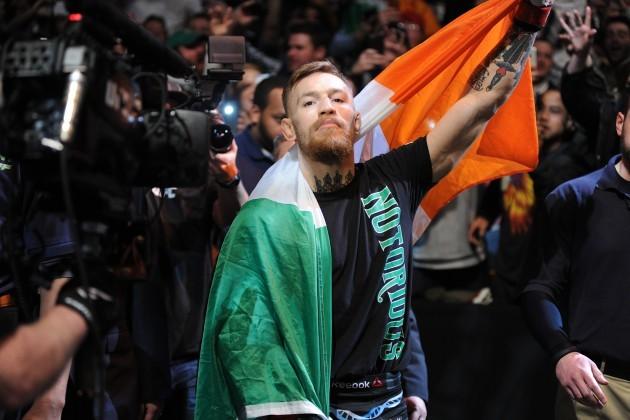 Conor McGregor makes his way to the octagon
