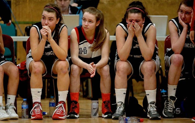 Saint Vincents Cork players dejected at the end of the game
