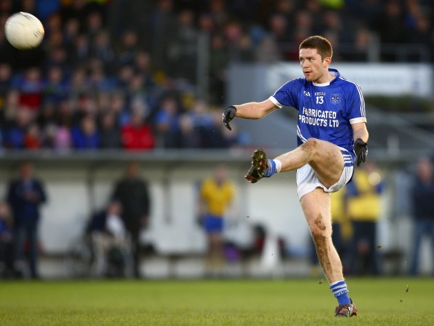 Cathal McInerney kicks a free