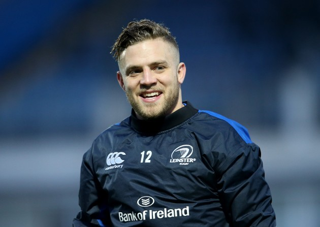 Ian Madigan warms up before the game