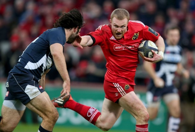 Keith Earls hands off Luke McLean to run in for a try
