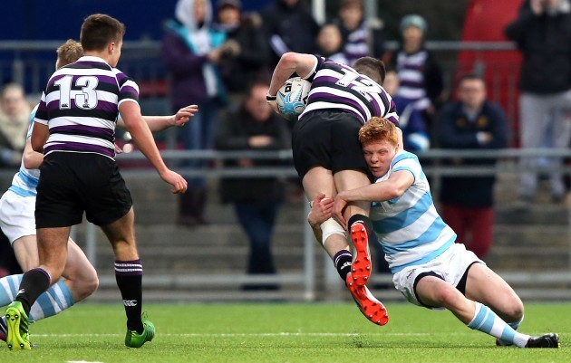 Cian Cooke is tackled by Gavin Mullen