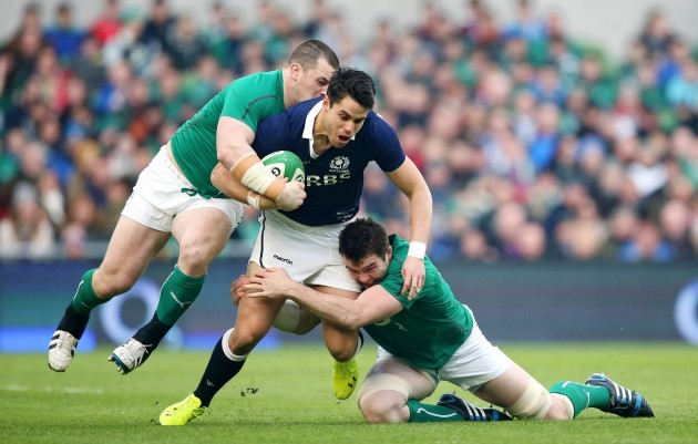 Sean Maitland is tackled by Cian Healy and Peter O'Mahony