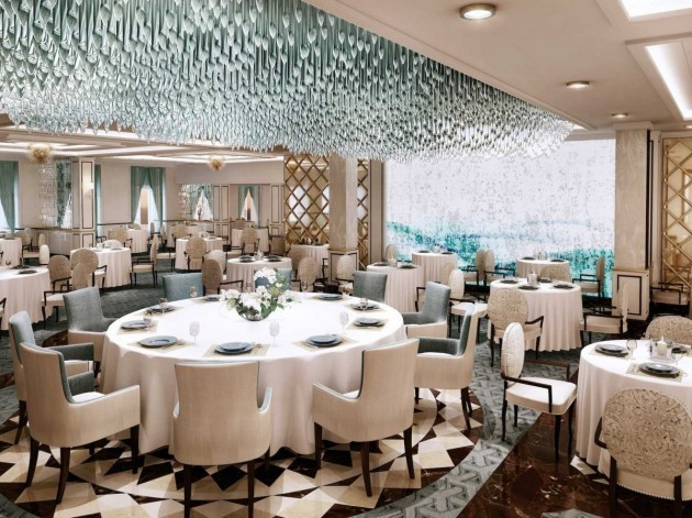 the-explorer-will-host-a-myriad-of-dining-options-starting-with-the-main-dining-room-the-compass-rose-all-seven-seas-ships-have-a-rose-dining-room-but-this-one-sports-a-modern-new-look-featuring-a-huge-cascading-blue-chandelier