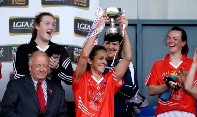 Caitlin Malone lifts the trophy