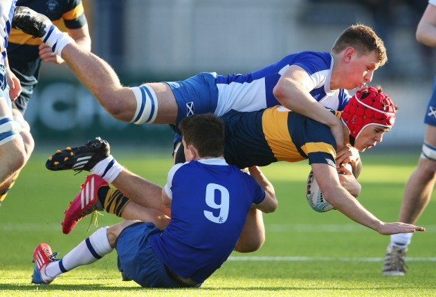 Paul McCullagh is tackled by James Black and Jonny Guy