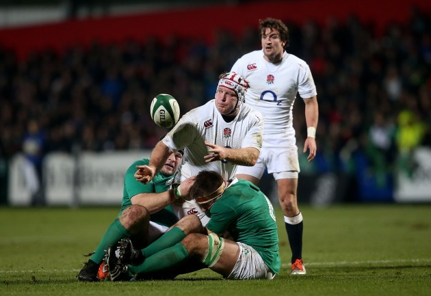 Mike Ross and Dominic Ryan tackle Thomas Waldrom