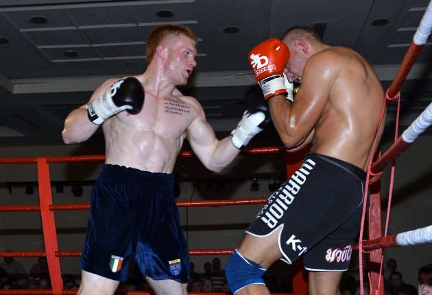 Steve Collings Jnr attempts to land some punches on Moses Matuvu 12/7/2013