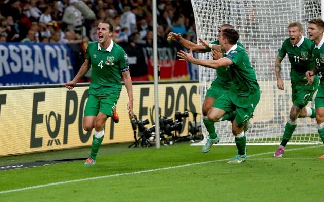 John O'Shea celebrates scoring