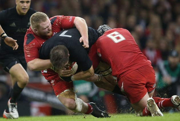 New Zealand All Blacks Richie McCaw is tackled by WalesÕs Samson Lee and Dan Lydiate 22/11//2014
