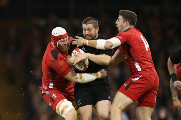 Dane Coles is tackled by Jake Ball and Alex Cuthbert