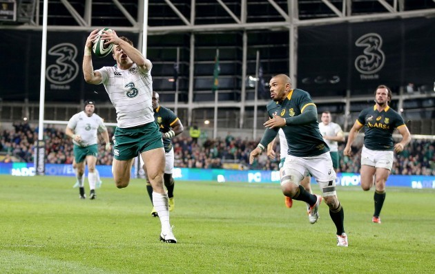 Tommy Bowe scores their second try despite Bryan Habana