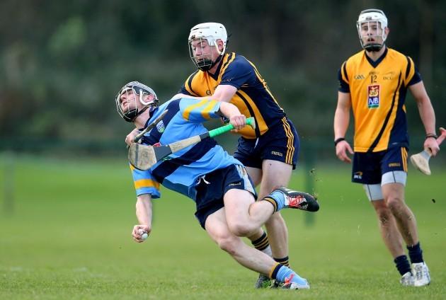 Joe Lyng is tackled by Cian Boland