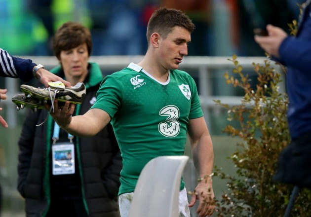 Ian Keatley gives away his boots after the game