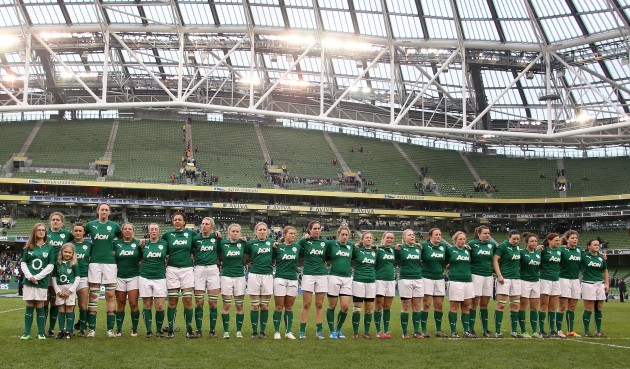 The women's team line up for the national anthem