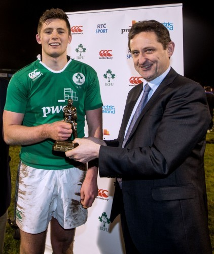 Ross Byrne receives the man of the match award from Jim Dollard