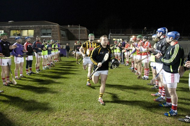 Cork players perform a guard of honour for the Kilkenny team before the game