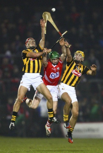 Daniel Kearney attempts to gather possession under pressure from Cillian Buckley and Geoff Brennan