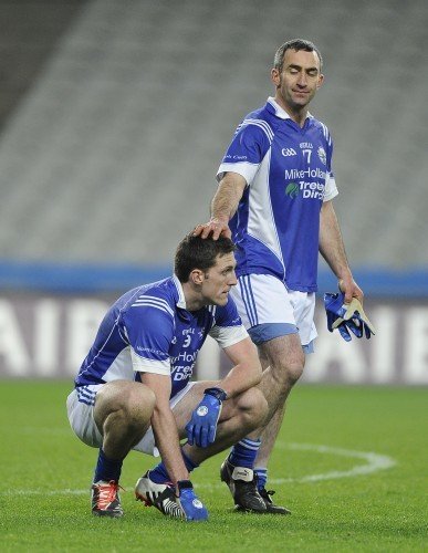 Brian Mullin is consoled by teammate Martin Towey at the end of the game