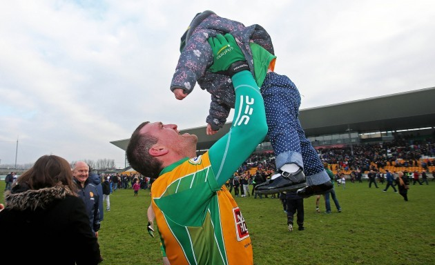 Gary Delaney celebrates with his daughter Kaya at the end of the game