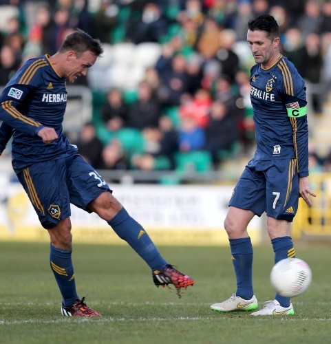Mika Varynen scores the first goal of the game as Robbie Keane looks on