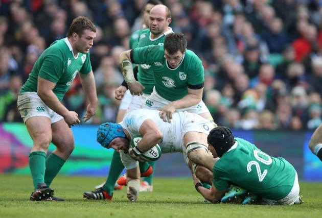 EnglandÕs James Haskell is tackled by IrelandÕs Jack McGrath Peter O'Mahony and Tommy OÕDonnell 1/3/2015