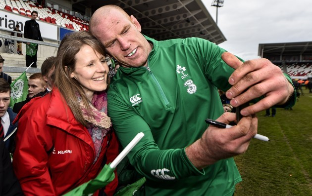 Eleanor Stevenson takes a picture with Paul O'Connell